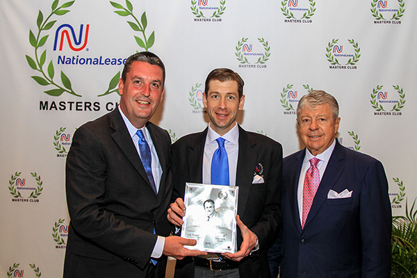 Dean Vicha (left), President of NationaLease, presented the coveted Gene Scoggins Sales Award to Salem NationaLease's Lacy Teague (center), standing with Thomas Teague.